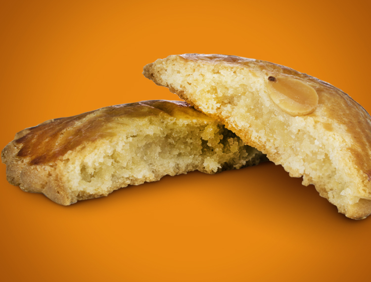 An Almond Round broken into two pieces shows the delicious almond filling.