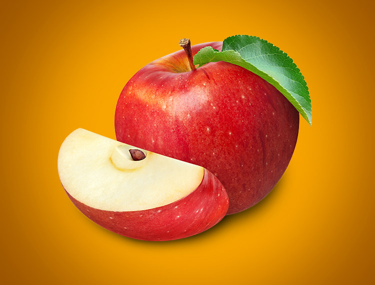 An juicy, red apple and apple slices — the filling for our delicious Apple Mini Delights