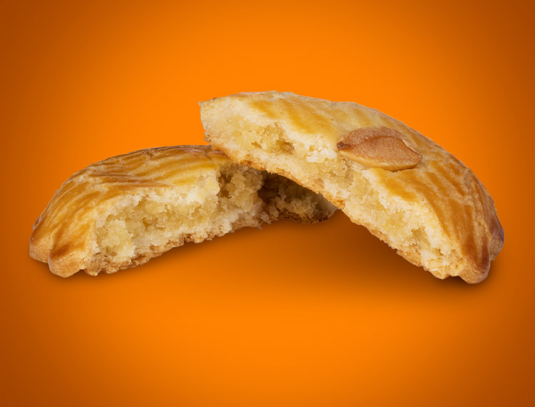 An Almond Mini Delight is broken into two pieces to show almond filling.