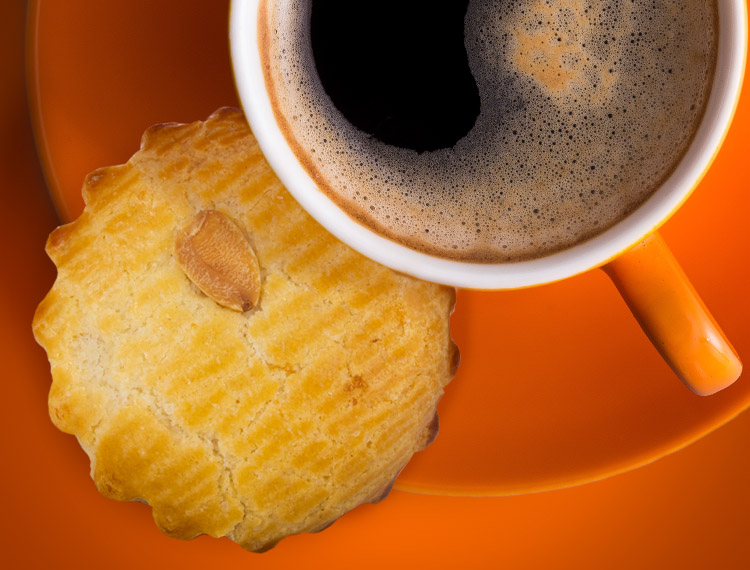 An Almond Mini Delight served with coffee
