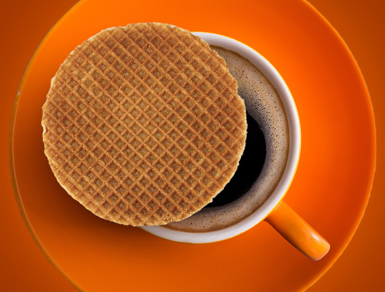 A Stroopwafel warms over a cup of hot coffee